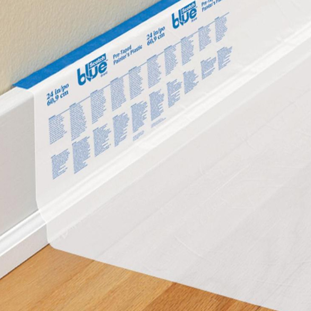 Scotch Blue Pre-Taped Painters Plastic applied to baseboard