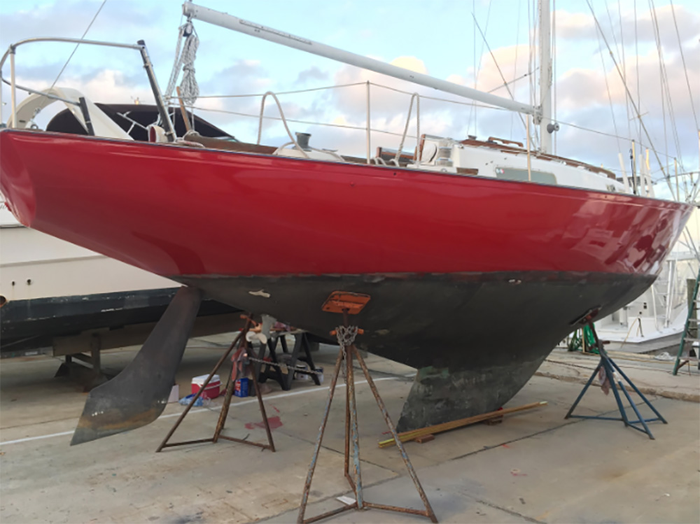 TotalBoat Wet Edge Topside Paint Fire Red on a sailboat hull